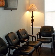 dark waiting room with black chairs