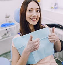 Smiling woman in the dental chair
