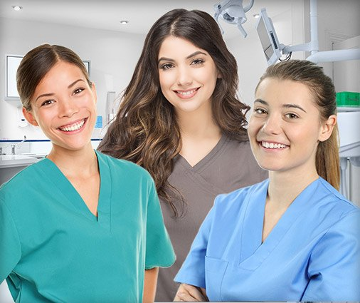Three female dental hygienists smiling