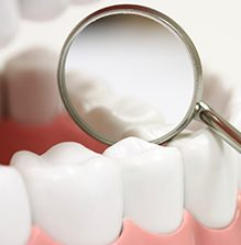Dental inspection mirror on  teeth
