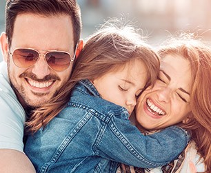 Couple laughing with their child